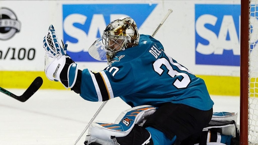 San Jose Sharks goalie Aaron Dell makes a save on a shot from the Dallas Stars during the second period of an NHL hockey game Sunday, March 12, 2017, in San Jose, Calif. (AP Photo/Ben Margot)
