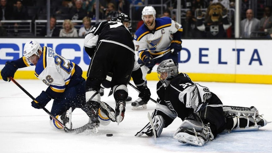 St. Louis Blues center Paul Stastny, left, takes a shot against Los Angeles Kings goalie Jonathan Quick, right, during the first period of an NHL hockey game in Los Angeles, Monday, March 13, 2017. (AP Photo/Alex Gallardo)