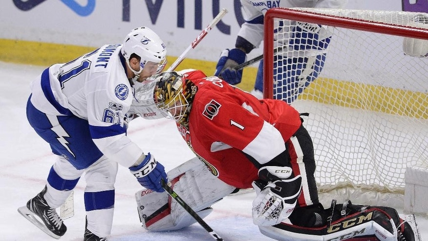 Tampa Bay Lightning's Gabriel Dumont (61) tries to get the puck past Ottawa Senators' goalie Mike Condon (1) during third period NHL hockey action in Ottawa, Tuesday March 14, 2017. (Justin Tang/The Canadian Press via AP)