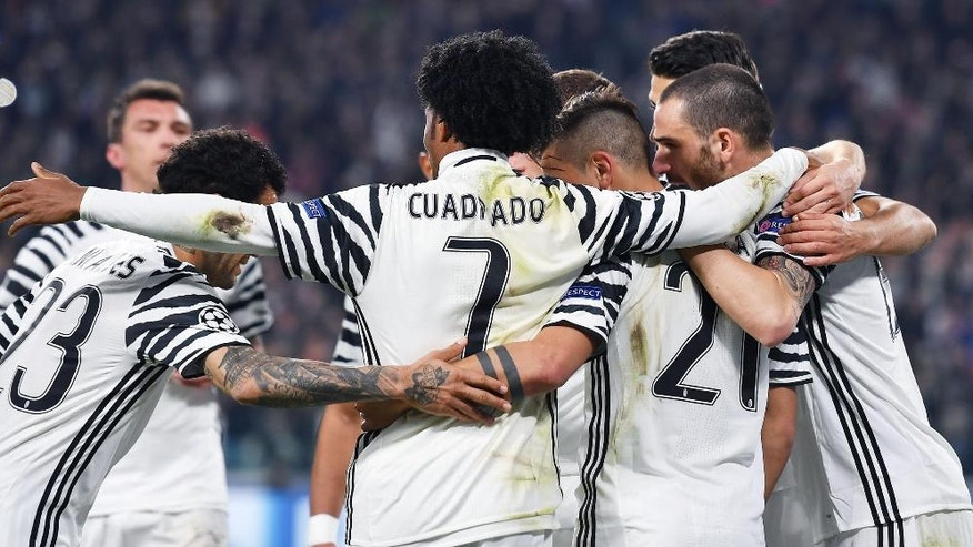 Juventus players celebrate after Paulo Dybala scored on a penalty kick during a Champions League round of 16, second leg soccer match, between Juventus and Porto at the Juventus stadium in Turin, Italy, Tuesday, March 14, 2017. (Alessandro Di Marco/ANSA via AP)