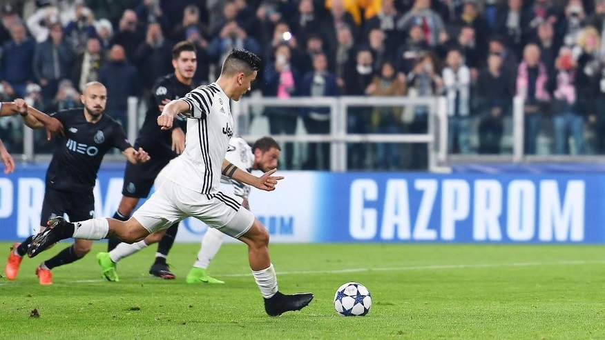 Juventus' Paulo Dybala scores on penalty kick during a Champions League round of 16, second leg soccer match, between Juventus and Porto at the Juventus stadium in Turin, Italy, Tuesday, March 14, 2017. (Alessandro Di Marco/ANSA via AP)