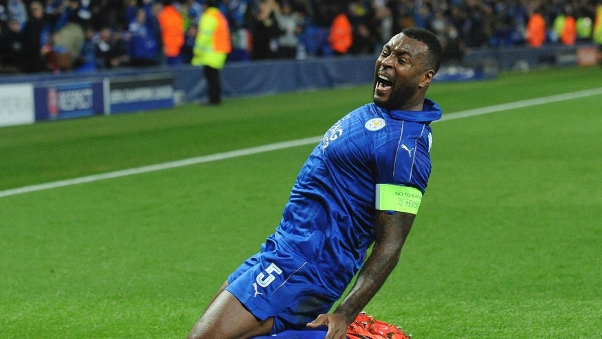 Leicester's Wes Morgan celebrates after he scores a goal during the Champions League round of 16 second leg soccer match between Leicester City and Sevilla at the King Power Stadium in Leicester, England, Tuesday, March 14, 2017. (AP Photo/Rui Vieira)