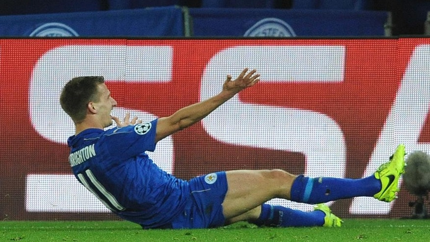 Leicester's Marc Albrighton celebrates after he scores a goal during the Champions League round of 16 second leg soccer match between Leicester City and Sevilla at the King Power Stadium in Leicester, England, Tuesday, March 14, 2017. (AP Photo/Rui Vieira)