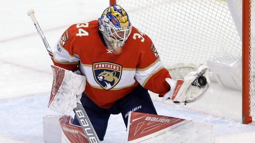 Florida Panthers goalie James Reimer (34) stops a shot in the third period of an NHL hockey game, Tuesday, March 14, 2017, in Sunrise, Fla. The Panthers won 7-2. (AP Photo/Alan Diaz)