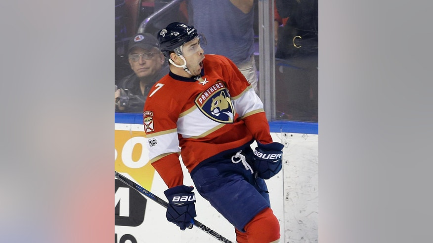 Florida Panthers center Colton Sceviour (7) celebrates after scoring against the Toronto Maple Leafs in the first period of an NHL hockey game, Tuesday, March 14, 2017, in Sunrise, Fla. (AP Photo/Alan Diaz)
