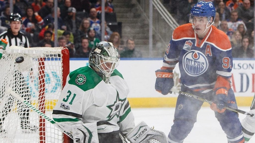 Dallas Stars' Antti Niemi (31) makes a save as Edmonton Oilers' Ryan Nugent-Hopkins (93) looks for a rebound during the second period of an NHL hockey game in Edmonton, Alberta, Tuesday, March 14, 2017. (Jason Franson/The Canadian Press via AP)