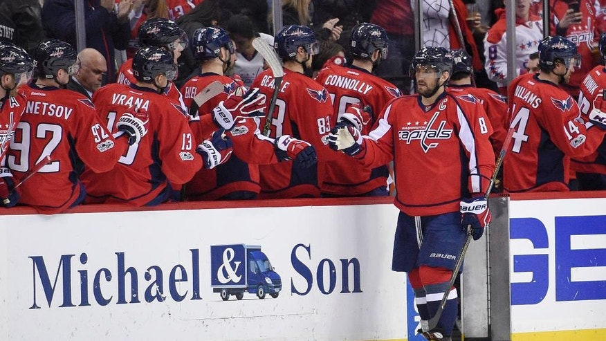 Washington Capitals left wing Alex Ovechkin (8), of Russia, celebrates his goal during the second period of an NHL hockey game Minnesota Wild, Tuesday, March 14, 2017, in Washington. (AP Photo/Nick Wass)