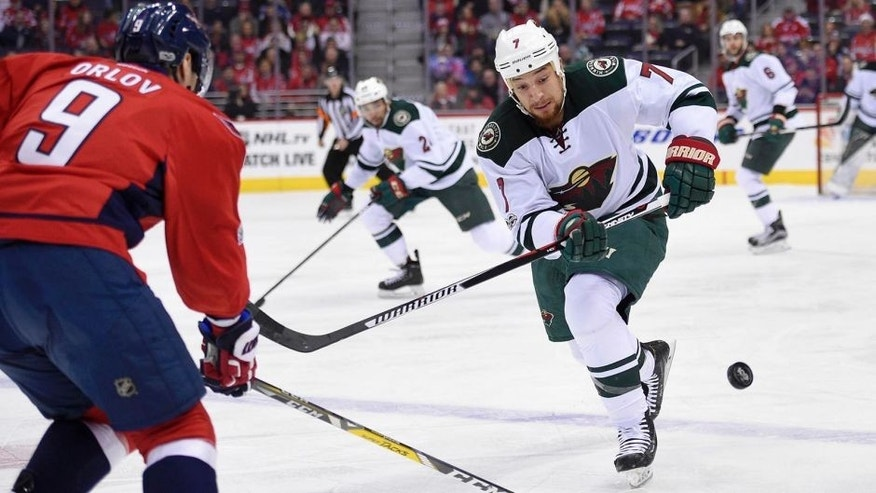 Minnesota Wild right wing Chris Stewart (7) chases the puck against Washington Capitals defenseman Dmitry Orlov (9), of Russia, during the first period of an NHL hockey game, Tuesday, March 14, 2017, in Washington. (AP Photo/Nick Wass)