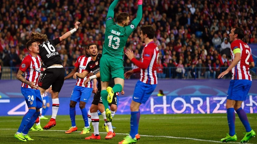 Atletico goalkeeper Jan Oblak makes a save during the Champions League round of 16 second leg soccer match between Atletico Madrid and Bayer Leverkusen at the Vicente Calderon stadium in Madrid, Spain, Wednesday, March 15, 2017. (AP Photo/Daniel Ochoa de Olza)