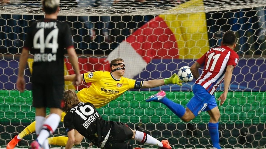 Leverkusen goalkeeper Bernd Leno saves Atletico's Angel Correa's shot during the Champions League round of 16 second leg soccer match between Atletico Madrid and Bayer Leverkusen at the Vicente Calderon stadium in Madrid, Spain, Wednesday, March 15, 2017. (AP Photo/Daniel Ochoa de Olza)