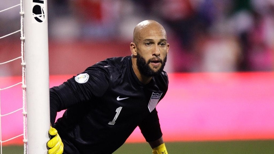 FILE - In this Sept. 10, 2013, file photo, United States' Tim Howard covers the goal during a World Cup qualifying soccer match against Mexioc in Columbus, Ohio. Howard was selected for the U.S. roster by coach Bruce Arena on Wednesday, March 15, 2017, for the team's World Cup qualifiers against Honduras and Panama. (AP Photo/Jay LaPrete, File)