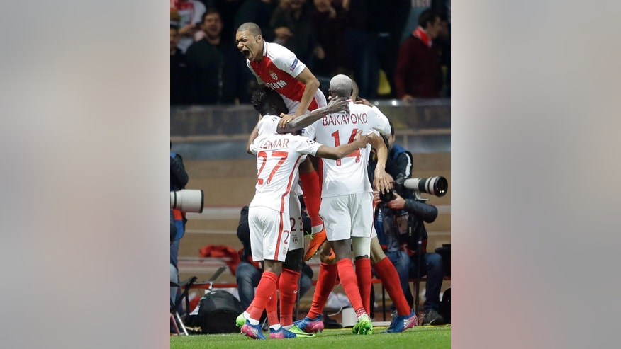 Monaco's players celebrate their side's 2nd goal during a Champions League round of 16 second leg soccer match between Monaco and Manchester City at the Louis II stadium in Monaco, Wednesday March 15, 2017. (AP Photo/Claude Paris)