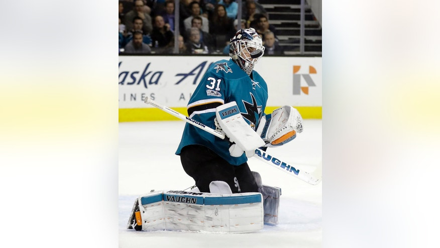 San Jose Sharks goalie Martin Jones stops a shot on goal against the Buffalo Sabres during the first period of an NHL hockey game, Tuesday, March 14, 2017, in San Jose, Calif. (AP Photo/Marcio Jose Sanchez)