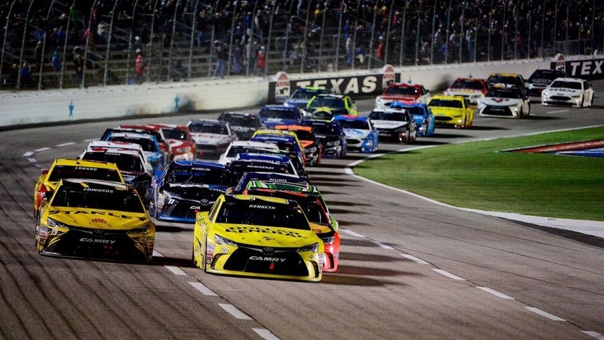 FORT WORTH, TEXAS - APRIL 09: Matt Kenseth, driver of the #20 Dollar General Toyota, leads the field in a restart during the NASCAR Sprint Cup Series Duck Commander 500 at Texas Motor Speedway on April 9, 2016 in Fort Worth, Texas. (Photo by Robert Laberge/NASCAR via Getty Images)