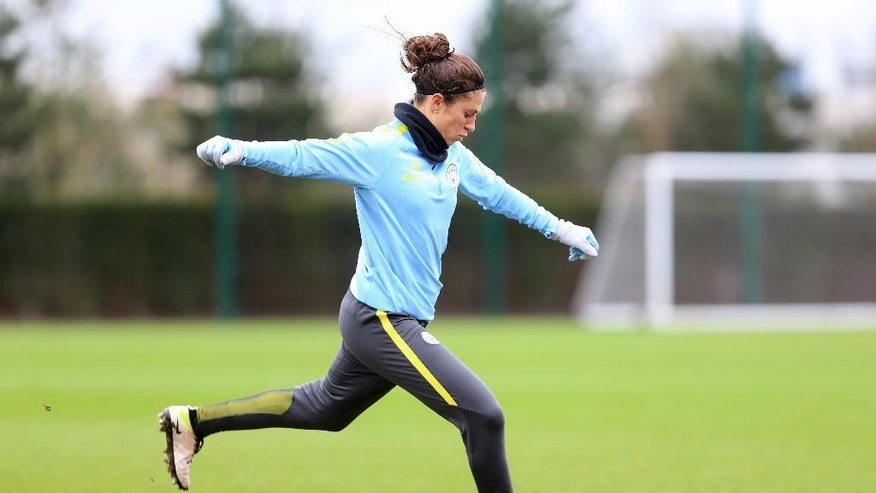 Manchester City's new signing for their women's team Carli Lloyd from the US  kicks the ball during a training session in Manchester England Tuesday March 14, 2017. Carli Lloyd's eyes light up when she talks about the opportunities that have opened up through her short-term move to Manchester City. Two days in and she has already been dazzled by the lavish soccer facility where she'll train, play and spend much of her time in England _the $300 million, 80-acre City Football Academy. (Tom Flathers via AP)