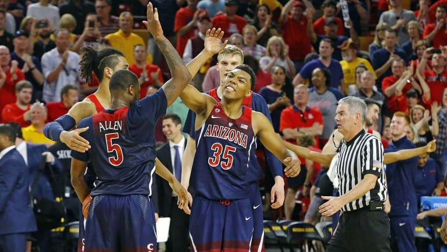 Mar 4, 2017; Tempe, AZ, USA; Arizona Wildcats guard Kadeem Allen (5), forward Keanu Pinder (25) and guard Allonzo Trier (35) celebrate their 73-60 win over the Arizona State Sun Devils at Wells-Fargo Arena. Mandatory Credit: David Kadlubowski/The Arizona Republic via USA TODAY NETWORK