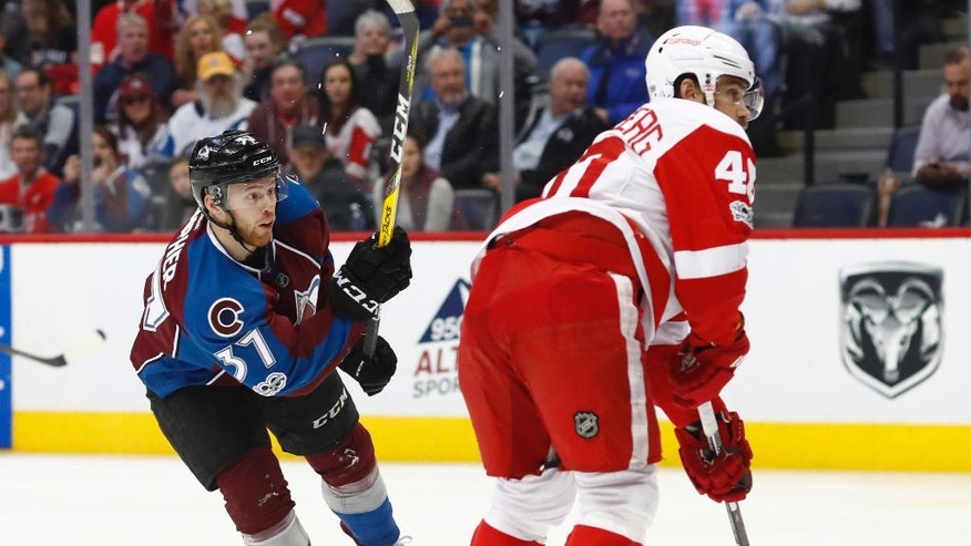 Colorado Avalanche left wing J.T. Compher, left, watches his shot for a goal past Detroit Red Wings left wing Henrik Zetterberg, of Sweden, during the third period of an NHL hockey game Wednesday, March 15, 2017, in Denver. The Avalanche won 3-1. (AP Photo/David Zalubowski)