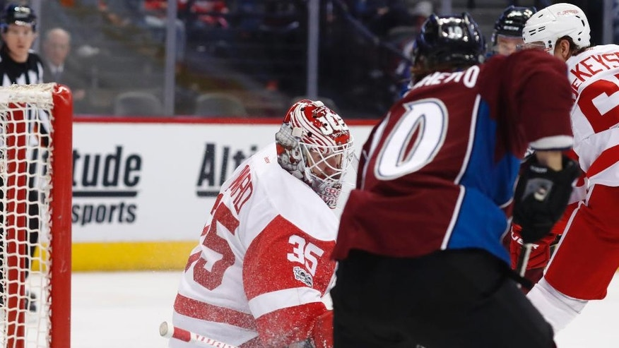 Colorado Avalanche right wing Sven Andrighetto, of Switzerland, has his shot deflected by Detroit Red Wings goalie Jimmy Howard during the first period of an NHL hockey game Wednesday, March 15, 2017, in Denver. (AP Photo/David Zalubowski)