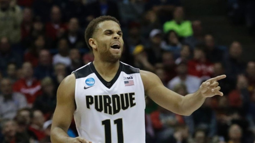 Purdue's P.J. Thompson celebrates during the second half of an NCAA college basketball tournament first-round game against Vermont Thursday, March 16, 2017, in Milwaukee. Purdue won 80-70. (AP Photo/Morry Gash)