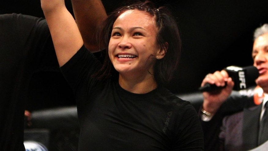 LAS VEGAS, NV - JULY 12: Michelle Waterson reacts to her victory over Angela Magana in their women's strawweight bout during the Ultimate Fighter Finale inside MGM Grand Garden Arena on July 12, 2015 in Las Vegas, Nevada. (Photo by Mitch Viquez/Zuffa LLC/Zuffa LLC via Getty Images)