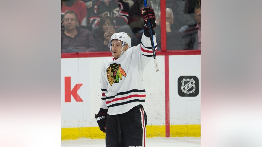 Chicago Blackhawks left wing Richard Panik celebrates his goal against the Ottawa Senators during the third period of an NHL hockey game in Ottawa, Ontario, Thursday, March 16, 2017. (Adrian Wyld/The Canadian Press via AP)