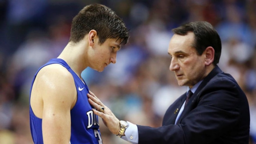 "FILE - In this March 10, 2016, file photo, Duke guard Grayson Allen (3) talks with coach Mike Krzyzewski during the team's NCAA college basketball game against Notre Dame in the Atlantic Coast Conference tournament in Washington. Krzyzewski handed down an ""indefinite"" suspension to Allen because Allen couldn't stop tripping opponents. The suspension turned out to last one game. (AP Photo/Alex Brandon, File)"