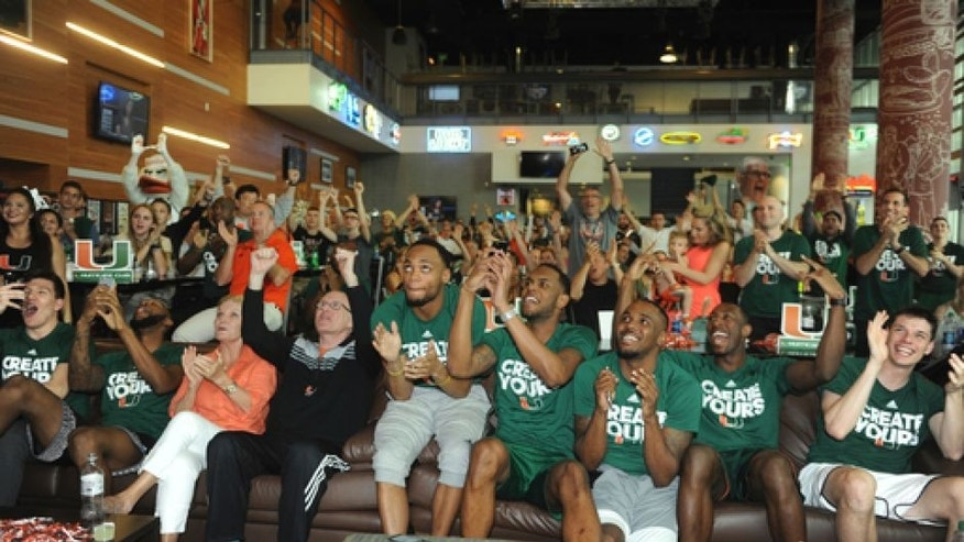 Miami basketball team members react while watching the NCAA men's basketball tournament selection show, Sunday, March 12, 2017, in Coral Gables, Fla The team plays Michigan State in Tulsa. (Joe Cavaretta/South Florida Sun-Sentinel via AP)