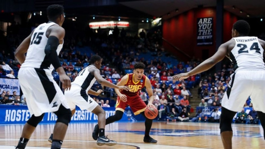 Southern California's Bennie Boatwright (25) looks to pass against Providence's Alpha Diallo (11) as Emmitt Holt (15) and Kyron Cartwright (24) watch during the second half of a First Four game of the NCAA men's college basketball tournament, Wednesday, March 15, 2017, in Dayton, Ohio. Southern California won 75-71. (AP Photo/John Minchillo)