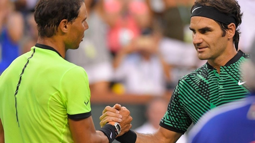 Roger Federer, of Switzerland, right, shakes hands with Rafael Nadal, of Spain, after their match at the BNP Paribas Open tennis tournament, Wednesday, March 15, 2017, in Indian Wells, Calif. Federer won 6-2, 6-3. (AP Photo/Mark J. Terrill)