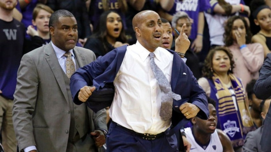 FILE - In this Feb. 18, 2017 file photo, Washington coach Lorenzo Romar, right, stands with assistant coach Michael Porter Sr., left, during an NCAA college basketball game against Arizona in Seattle. Washington announced Wednesday, March 15, 2017, that Romar had been fired after 15 seasons at the school. (AP Photo/Elaine Thompson, file)