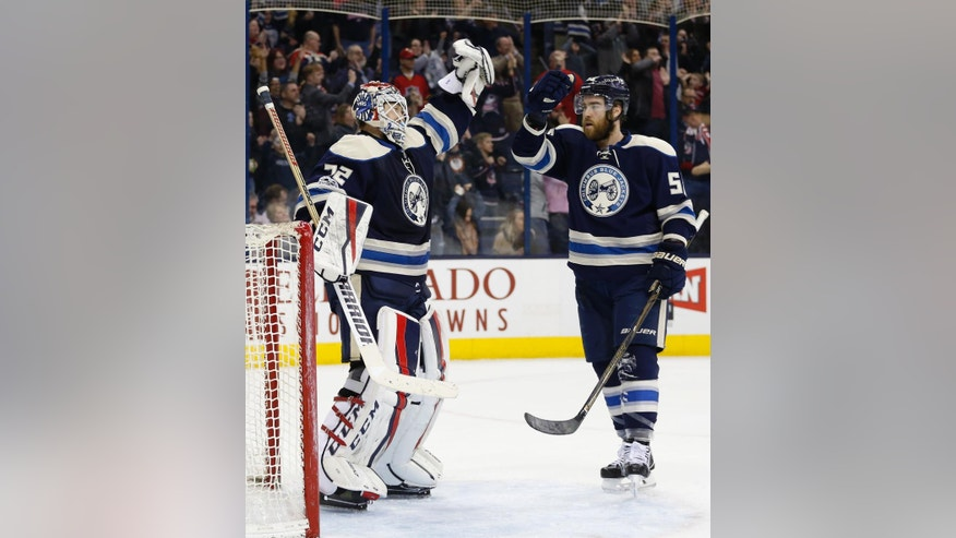 Columbus Blue Jackets' Sergei Bobrovsky, left, of Russia, celebrates their win against the Florida Panthers with David Savard at the end of an NHL hockey game Thursday, March 16, 2017, in Columbus, Ohio. The Blue Jackets beat the Panthers 2-1. (AP Photo/Jay LaPrete)