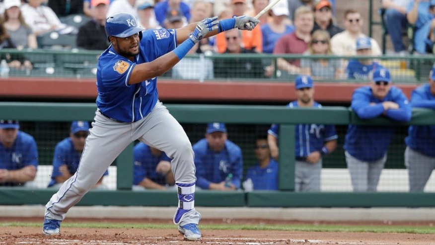 Kansas City Royals' Jorge Bonifacio hits a RBI single during the second inning of a spring training baseball game against the San Francisco Giants, Sunday, March 5, 2017, in Scottsdale, Ariz. (AP Photo/Darron Cummings)