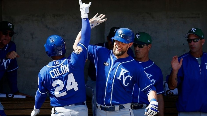 Kansas City Royals second baseman Christian Colon (24) celebrates his home run against the Milwaukee Brewers with right fielder Alex Gordon, right, during the second inning of a spring training baseball game Friday, March 17, 2017, in Phoenix. (AP Photo/Ross D. Franklin)