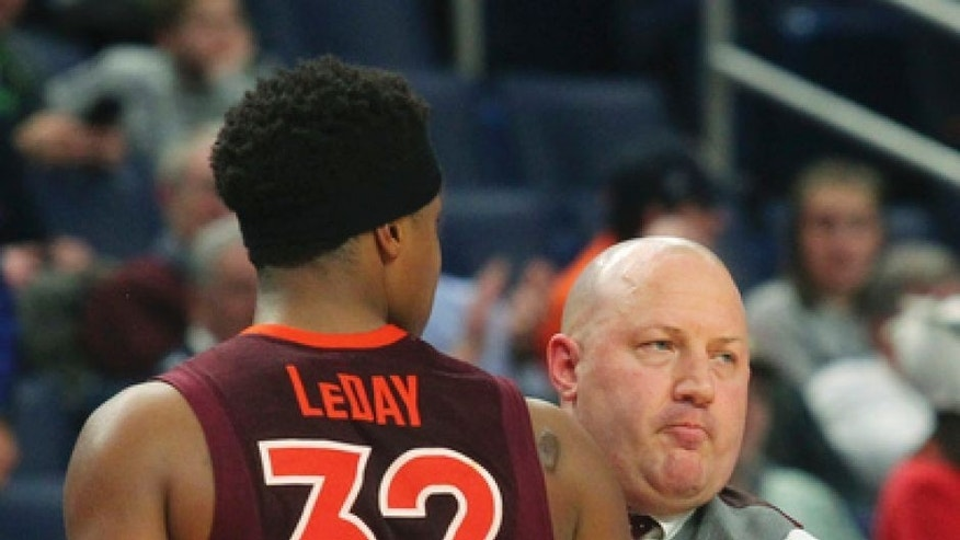 Virginia Tech forward Zach LeDay (32) hugs head coach Buzz Williams after fouling out during the second half of a first-round men's college basketball game in the NCAA Tournament, Thursday, March 16, 2017, in Buffalo, N.Y. Wisconsin won, 84-74. (AP Photo/Bill Wippert)