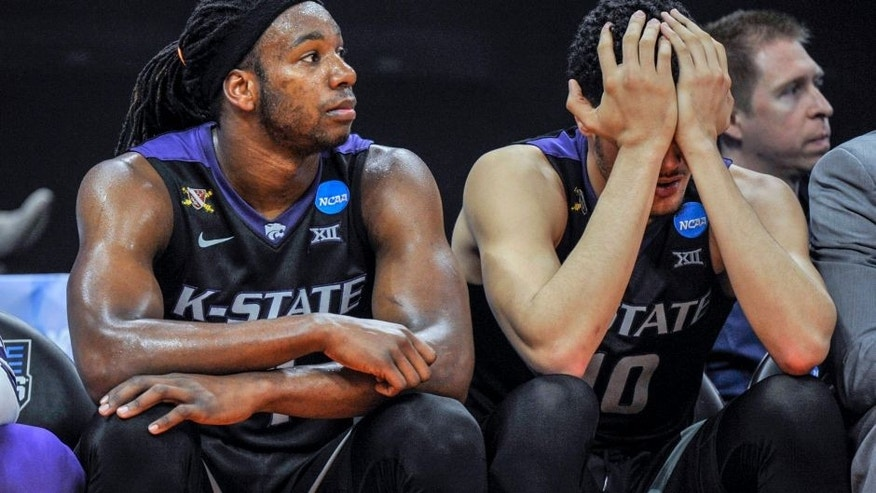 Kansas State forward Isaiah Maurice, right, puts his head in his hands as he and teammate D.J. Johnson watch the closing moments of the team's 75-61 loss to Cincinnati in a first-round game of the men's NCAA college basketball tournament in Sacramento, Calif., Friday, March 17, 2017. (AP Photo/Bryan Patrick)