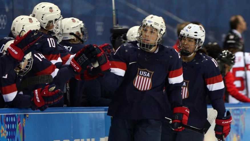 Feb 10, 2014; Sochi, RUSSIA; USA forward Hilary Knight (21) celebrates with teammates after scoring a goal against Switzerland in a women's preliminary round women's ice hockey game during the Sochi 2014 Olympic Winter Games at Shayba Arena. Mandatory Credit: Winslow Townson-USA TODAY Sports