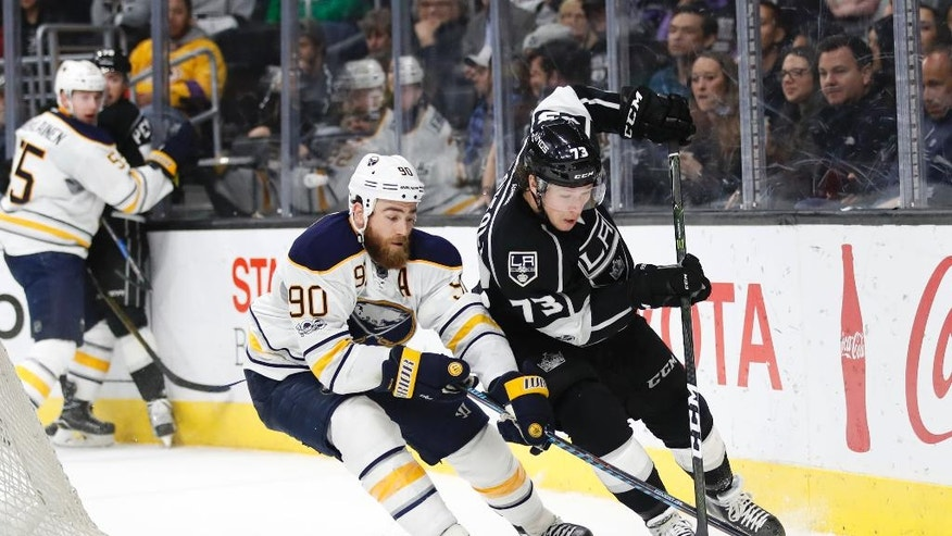 Los Angeles Kings' Tyler Toffoli, right, moves the puck as Buffalo Sabres' Ryan O'Reilly defends during the second period of an NHL hockey game Thursday, March 16, 2017, in Los Angeles. (AP Photo/Jae C. Hong)