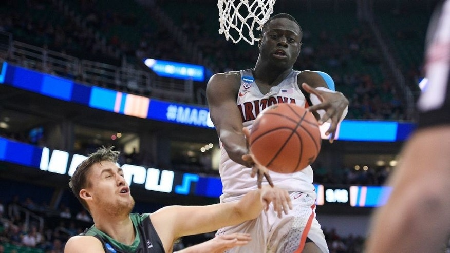 March 16, 2017; Salt Lake City, UT, USA; Arizona Wildcats guard Rawle Alkins (1) plays for the ball against North Dakota Fighting Hawks center Carson Shanks (5) during the second half in the first round of the NCAA tournament at Vivint Smart Home Arena. Mandatory Credit: Kelvin Kuo-USA TODAY Sports