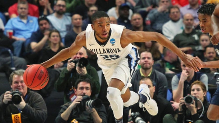 Villanova guard Mikal Bridges (25) handles the ball during the second half of a first-round men's college basketball game against Mount St. Mary's in the NCAA Tournament, Thursday, March 16, 2017, in Buffalo, N.Y. Villanova won, 76-56. (AP Photo/Bill Wippert)