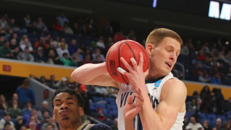 Villanova guard Donte DiVincenzo (10) grabs a rebound against Mount St. Mary's forward Chris Wray (5) during the first half of a first-round men's college basketball game in the NCAA Tournament, Thursday, March 16, 2017, in Buffalo, N.Y. (AP Photo/Bill Wippert)