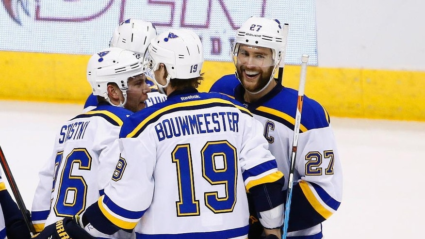 St. Louis Blues defenseman Alex Pietrangelo (27) smiles as he celebrates his goal against the Arizona Coyotes with defenseman Jay Bouwmeester (19) and center Paul Stastny, left, during the first period of an NHL hockey game Saturday, March 18, 2017, in Glendale, Ariz. (AP Photo/Ross D. Franklin)