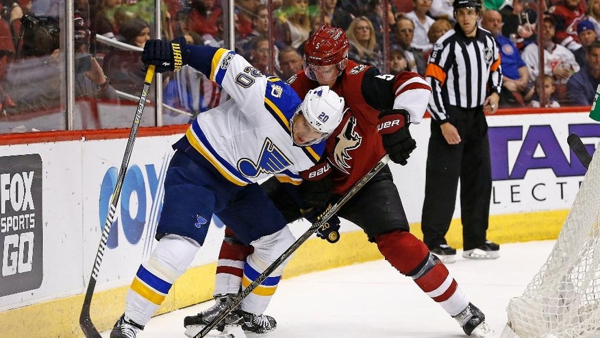 Arizona Coyotes defenseman Connor Murphy (5) and St. Louis Blues left wing Alexander Steen (20) battle for the puck during the second period of an NHL hockey game Saturday, March 18, 2017, in Glendale, Ariz. (AP Photo/Ross D. Franklin)