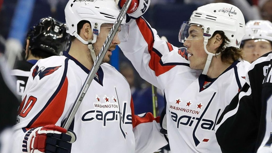 Washington Capitals right wing T.J. Oshie, right, celebrates with left wing Marcus Johansson (90) after scoring against the Tampa Bay Lightning during the first period of an NHL hockey game Saturday, March 18, 2017, in Tampa, Fla. (AP Photo/Chris O'Meara)