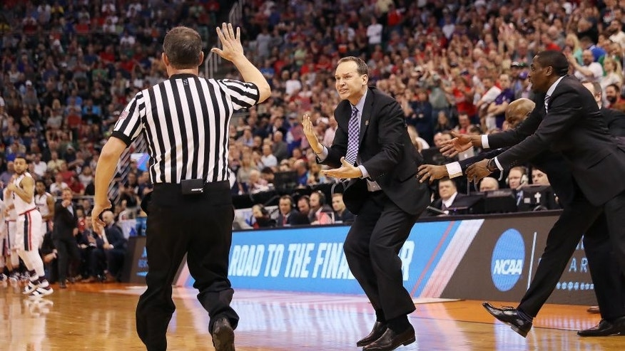 SALT LAKE CITY, UT - MARCH 18: Head coach Chris Collins of the Northwestern Wildcats is called for a technical foul against the Gonzaga Bulldogs during the second round of the 2017 NCAA Men's Basketball Tournament at Vivint Smart Home Arena on March 18, 2017 in Salt Lake City, Utah. (Photo by Christian Petersen/Getty Images)