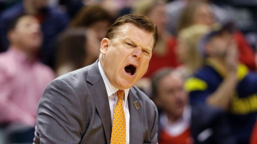Oklahoma State head coach Brad Underwood yells from the sideline during a first-round game against Michigan in the men's NCAA college basketball tournament in Indianapolis, Friday, March 17, 2017. (AP Photo/Michael Conroy)