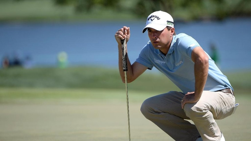 Kevin Kisner lines up a putt for birdie on the seventh green during the third round of the Arnold Palmer Invitational golf tournament in Orlando, Fla., Saturday, March 18, 2017. (AP Photo/Phelan M. Ebenhack)