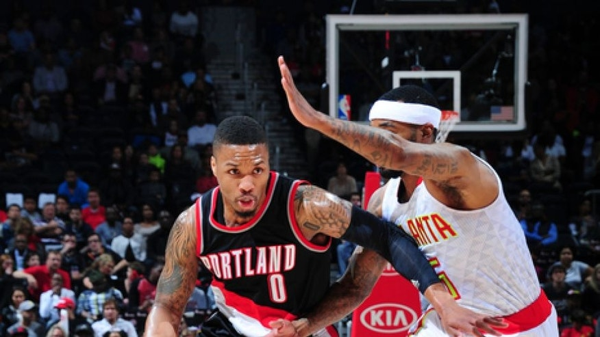 ATLANTA, GA - MARCH 18: Damian Lillard #0 of the Portland Trail Blazers drives to the basket against the Atlanta Hawks during the game on March 18, 2017 at Philips Arena in Atlanta, Georgia. NOTE TO USER: User expressly acknowledges and agrees that, by downloading and/or using this Photograph, user is consenting to the terms and conditions of the Getty Images License Agreement. Mandatory Copyright Notice: Copyright 2017 NBAE (Photo by Scott Cunningham/NBAE via Getty Images)