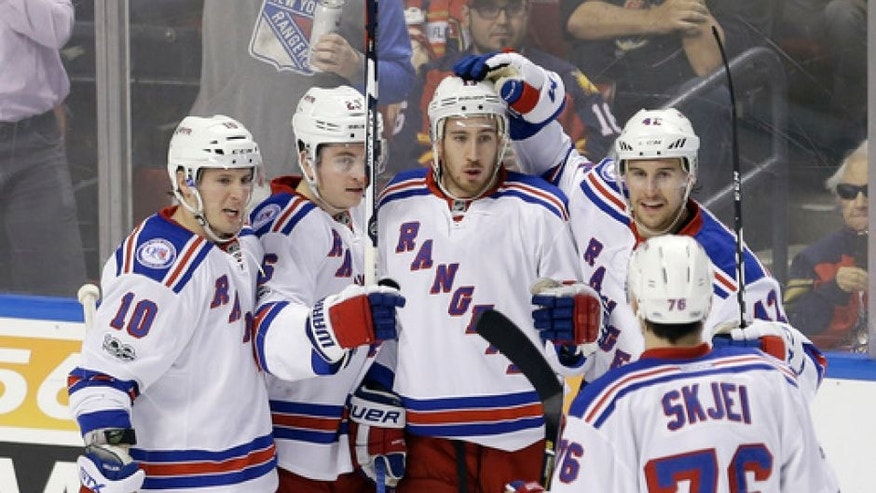 New York Rangers center Kevin Hayes (13) celebrates with teammates J.T. Miller (10), Jimmy Vesey (26), Brendan Smith (42) and Brady Skjei (76) after Hayes scored against the Florida Panthers in the second period of an NHL hockey game, Tuesday, March 7, 2017, in Sunrise, Fla. (AP Photo/Alan Diaz)