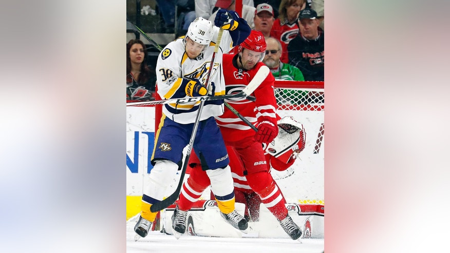 Nashville Predators' Viktor Arvidsson (38) and Carolina Hurricanes' Ryan Murphy (7) prepare to be hit by a shot during the second period of an NHL hockey game, Saturday, March 18, 2017, in Raleigh, N.C. (AP Photo/Karl B DeBlaker)