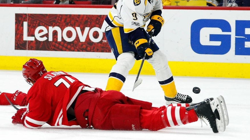 Carolina Hurricanes' Jaccob Slavin (74) goes down to the ice to defends the shot of Nashville Predators' Filip Forsberg (9) during the first period of an NHL hockey game, Saturday, March 18, 2017, in Raleigh, N.C. (AP Photo/Karl B DeBlaker)